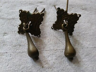 two antique brass door or drawer drop pull handles