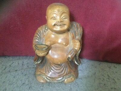 Old Wooden Buddha Depicting a Happy Buddha With Toothy Grin & Holding Fruit Etc