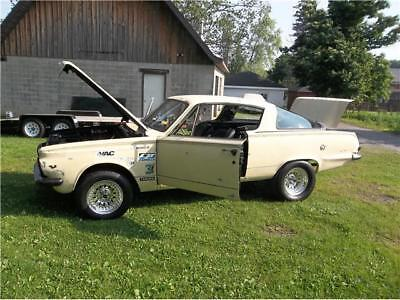 Barracuda -- 1965 plymouth barracuda  32,322 Miles yellow  v8 Automatic