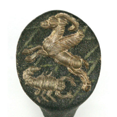 A Sassanian bronze ring depicting a winged gazelle and scorpion x9416