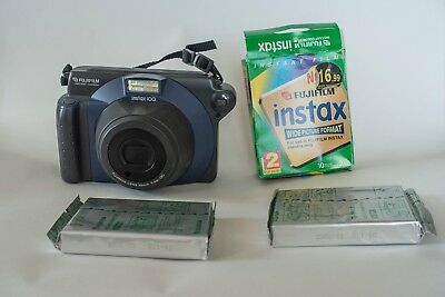 Fujifilm instant camera install 100 with fujinon lens 95mm with 2 film packs