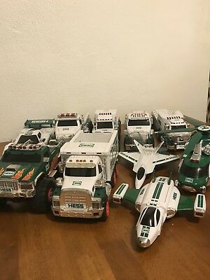 Lot of 10 Hess Toy Trucks, Planes and Helicopter All Different Sizes