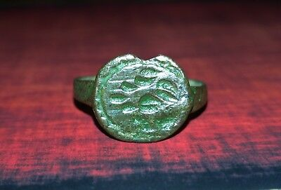 An ancient bronze ring with an original ornament.XVII century