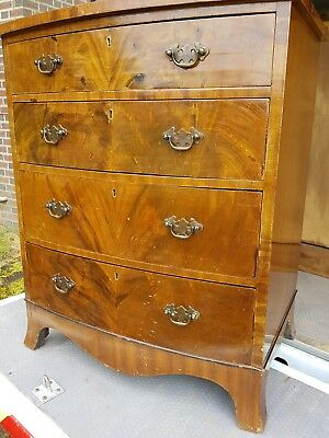 Antique style walnut bow front chest of drawers
