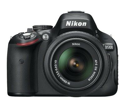 Nikon D5100 DSLR (body) with 3 batteries, remote, strap, SDHC Cards, charger