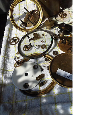 french clock parts hinged bezil with glass and straps dials etc