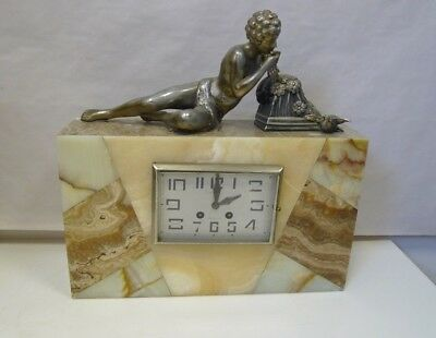 Art Deco marble effect clock with figurine playing wind instrument with key **