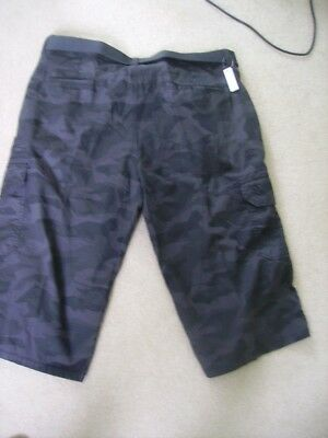 2 pairs Mens shorts/cut offs in size waist 40 inch one new one worn