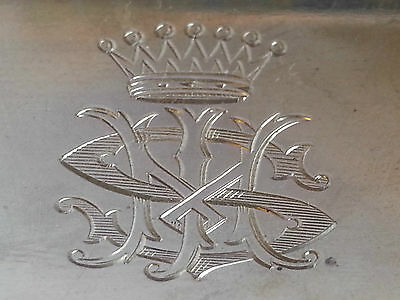 hand engraved crests & mongrams on to your family silverware by master engraver