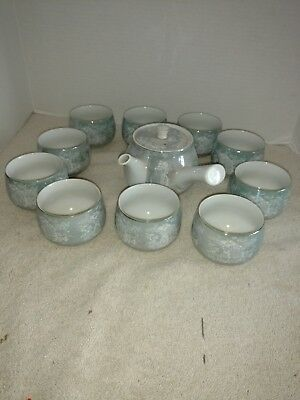unusual Japanese tea set with 10 cups. mint green with gold rims. No markings
