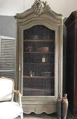 Original vintage French Louis XV armoire with Chicken Wire Door.