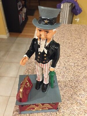 "VINTAGE CAST IRON ""UNCLE SAM"" MECHANICAL BANK this is a replica ."