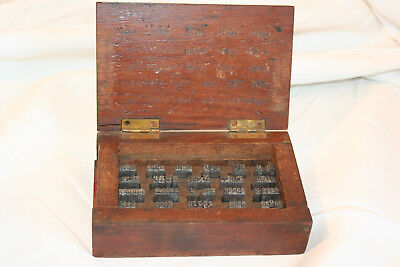 Antique box with printer's blocks / typewriter keys inside Waterlow and sons