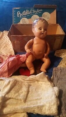 VINTAGE 1937 BOTTELTOT DOLL with box and handmade clothing.