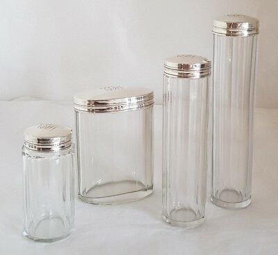 A set of four cut glass Dressing table vanity jars. London 1922 .By T & F Perry