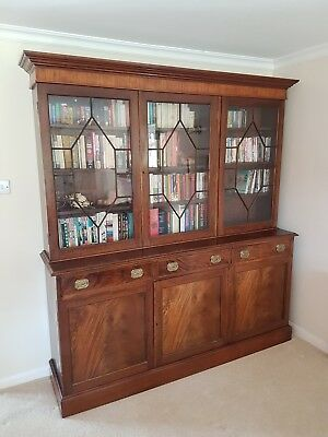 Antique glass-fronted bookcase and cupboard with 6 shelves and 3 sections