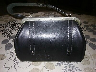 Antique doctor bag. (Not positive)could be old purse. It was found in an attic.