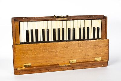 An Antique 3 Octive Practice Piano