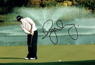 Rory McILROY SIGNED AUTOGRAPH 12x8 Photo 6 AFTAL COA European Golf Ryder Cup