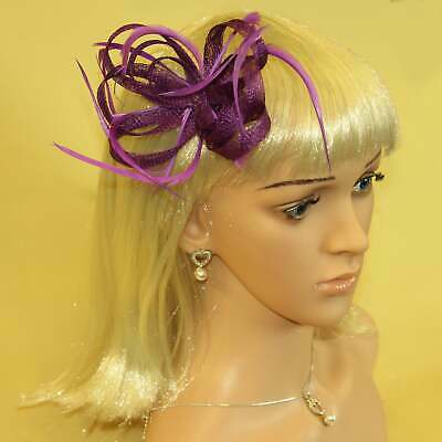 Purple fascinator with hessian loops and feather tendrils (beak and clip)