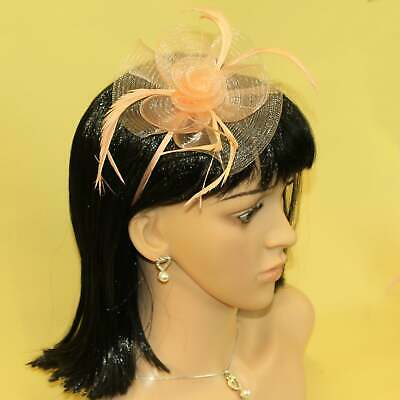 Peach fascinator with sinamay flower and feather tendrils on alice hair band