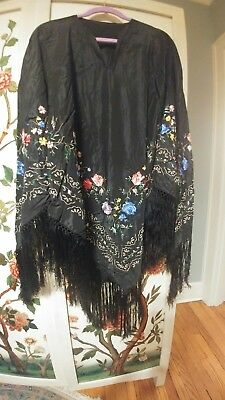 For sale one embroidered piano shawl made into poncho. Small hole in shoulder