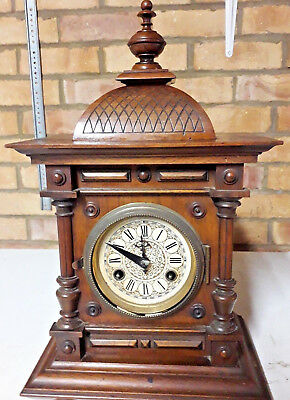 Antique Clock with wooden case and key