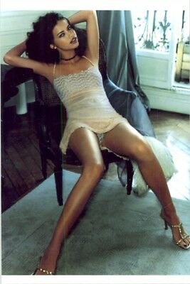 Adriana Lima - Sitting In Chair With Mini Dress - Showing Off Her Legs !!!