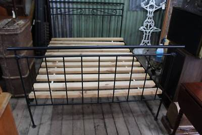 A Wrought Iron and Cast Iron Double Bed with Slats