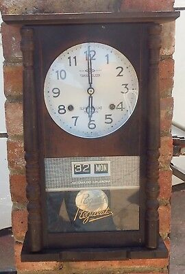 Vintage 70's TAKEDA Japanese cabinet mechanical wall clock with auto calendar