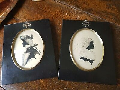 pair of signed hand painted silhouettes in ebonised minature frames