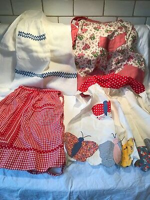 Group of 4 Vintage Aprons, some made of feed sack fabric