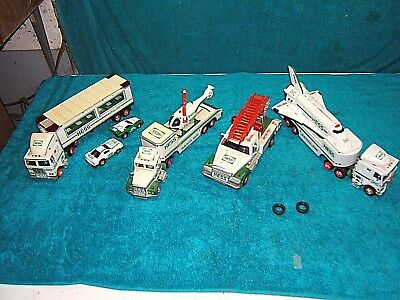 (Lot of 4) HESS Toy Semi Trucks Race Cars Helicopter space  shuttle car carrier