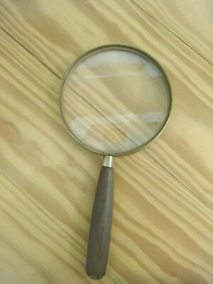"""Vintage Donegan Magnifying Glass. Heavy glass. 10"""" long. 5"""" wide. Made in U.S.A"""