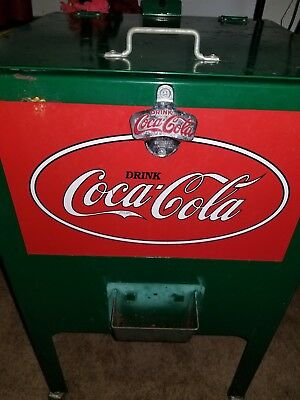 Vintage Coca Cola cooler on wheels Good Condition.  First $200 takes it.