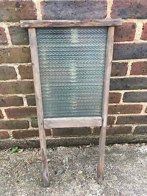 Antique glass and wood washboard
