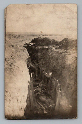 Antique WW1 GERMAN Real Photo RPPC Postcard DEAD SOLDIERS in BATTLEFIELD TRENCH