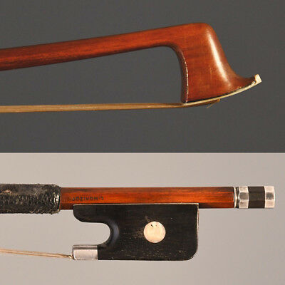 A fine used viola bow stamped L. Morizot.