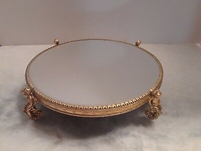 Vintage small mirrored footed stand
