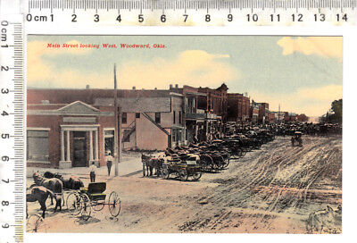 "WOODWARD, Okla - ""Main Street looking West..."" - Horse drawn wagons, buggies"