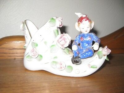 Porcelain  Shoe With A Elf Sitting On It