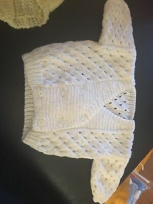 baby hand knitted white unisex cardigan. 0-3months
