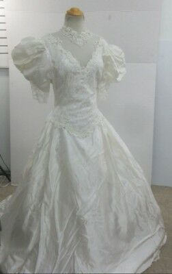 Beautiful mesh and beaded wedding gown with trail size 12 with fluffy underskirt