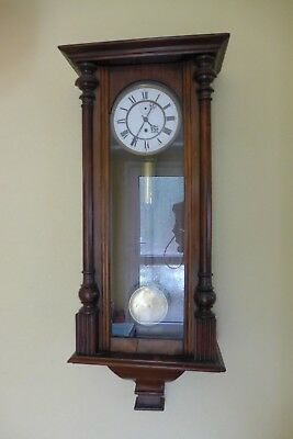 Beautiful antique pendulum clock in attractive wooden and glazed case
