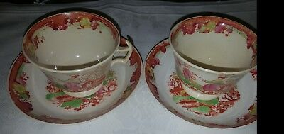 A pair of Chinese cups and Saucers