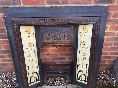 Victorian style cast iron fireplace with tiles