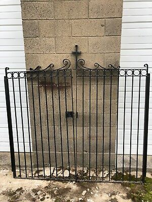 Antique Black wrought iron gate with cross