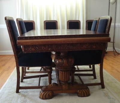 c. 1930 Carved Renaissance Revival Oak Extending Dining Table; 8 Matching Chairs