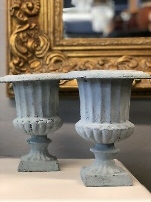 A Pair Of Cast Iron Vintage Mini Urns