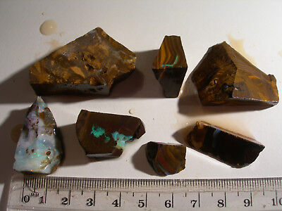 (Lot 611) 7 pieces Boulder Opal with interesting opal and rock for cutting.